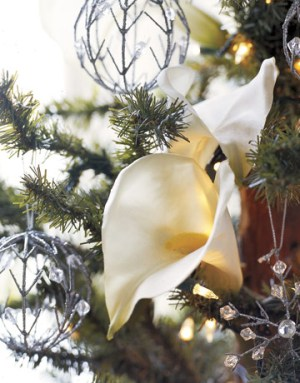 """Silk calla lilies lend a surprising note of spring. Bright idea: Let the basic style and colors of your home guide your holiday decorating, advises interior designer Rollande. """"The idea is to enhance, not overwhelm, the spaces you live in."""""""