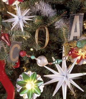 A tree is trimmed with vintage letters found from old signs, printers' type, and alphabet teaching aids.