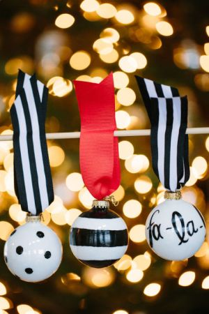 Dress up ordinary, white balls with some black-and-white designs...just make sure the ornament you buy is safe to bake in the oven. Get the tutorial at Handmade Mood »