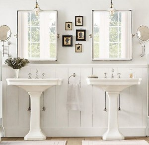 Amazing bathroom with his and her pedestal sinks