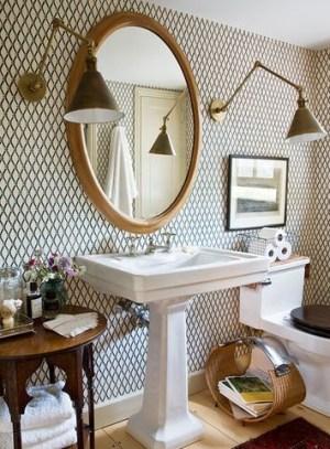 Golden-framed mirror and padedstal sink