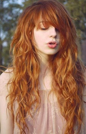 Long Red Locks Swept to the Side