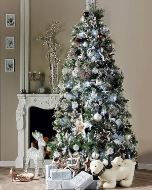 silver and white Christmas tree. Love the color combo, but maybe a little less for our house