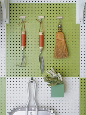 Use Nylon Tool Holders - 49 Brilliant Garage Organization Tips, Ideas and DIY Projects