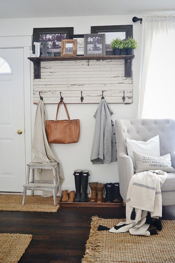 Carve out some space for a (pretty) mudroom with a rustic entryway coat rack and a few storage accessories to complete the nook. |
