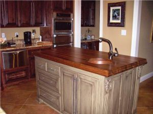 Walnut-Butcher-Block-Countertop-with-small-round-sink-and-chrome-sink-for-modern-kitchen-furniture-idea