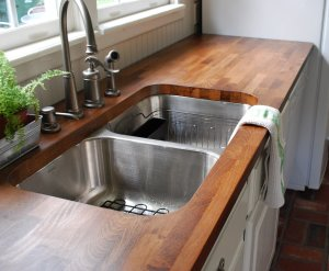 white-woode-cabinet-with-double-bowl-sink-and-butcher-block-countertop-for-chic-kitchen-furniture-idea