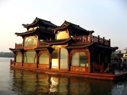 A West Lake pleasure boat sits serenely by the shore like a palace on water.