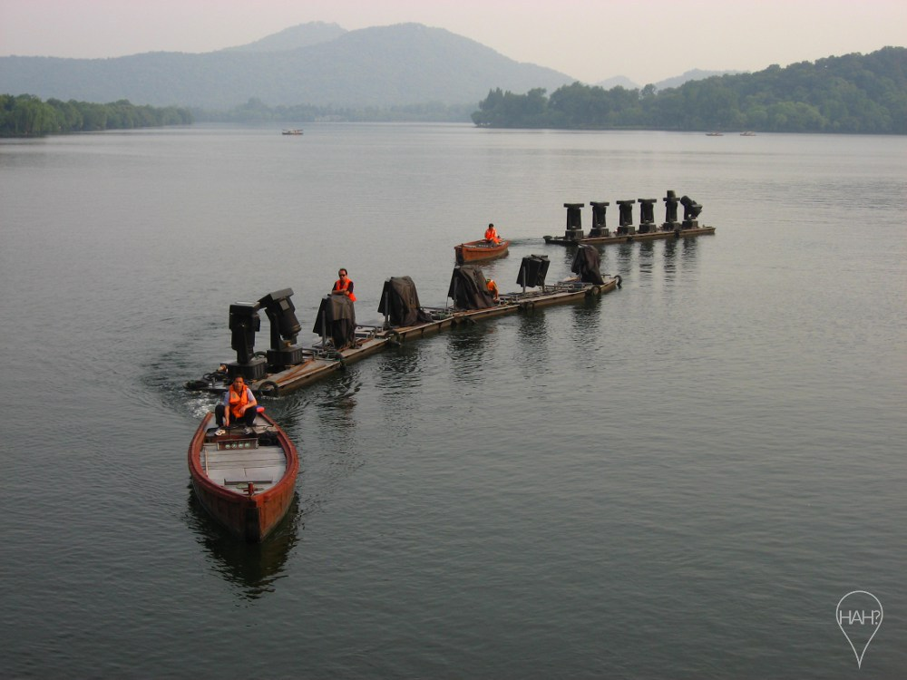 Crew prepare for Impression West Lake, Zhang Yimou's show on the water's edge.