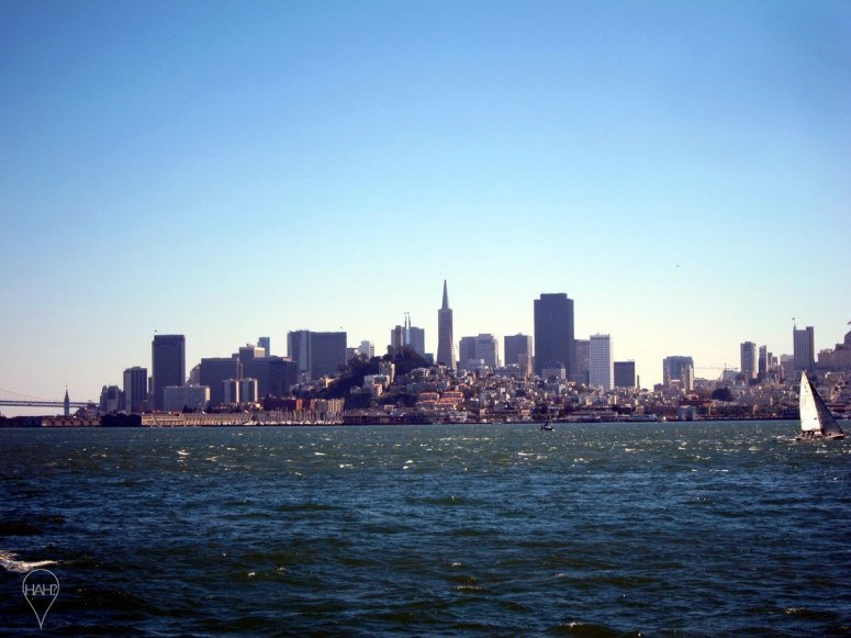 Seen from Alcatraz, the skyline of San Francisco is recognizable because of the Transamerica Pyramid.