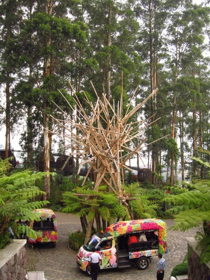 A bamboo installation and the shuttle vans at the Pasar Khatulistiwa