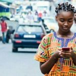 A Ghanian Lady Operating a phone