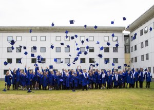 Howard Junior pupils throw their hats in celebration
