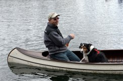 Mike Darga takes the pooch out for a paddle. Photo by Howard Meyerson.