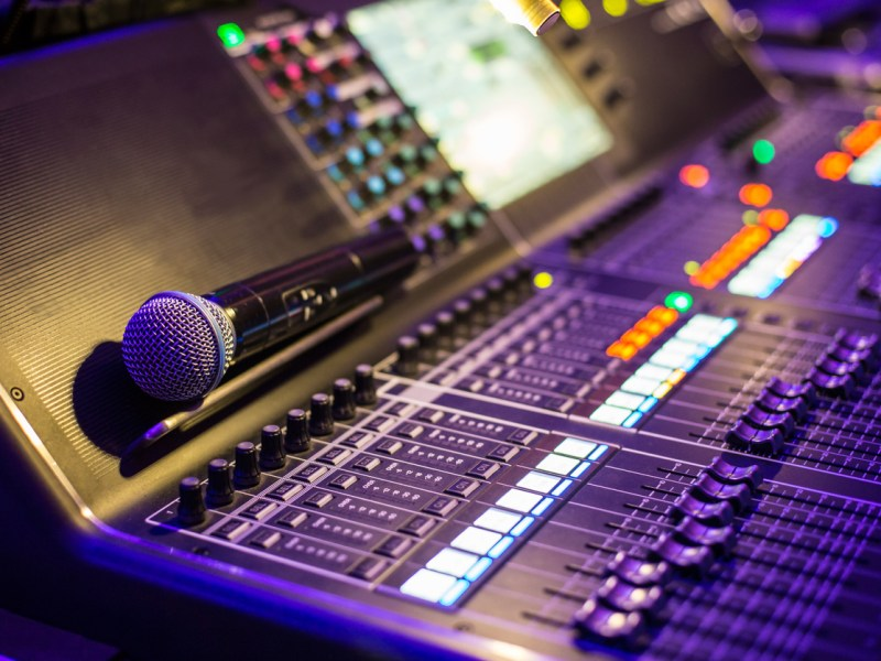 Large modern show sound controller with microphone on it - close up photo