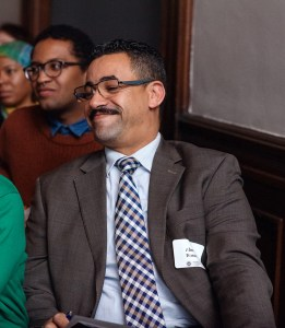 Portrait of Ahmed Nasser smiling at a Brooklyn Historical Society lecture.