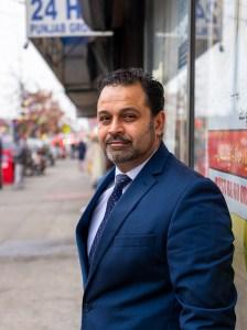 Portrait of Mohammad Razvi in front of COPA Community Center