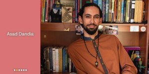 Meet Asad Dandia, portrait of Dandia in front of his library.