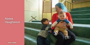 Meet Alyssa Haughwout, a woman wearing a blue hijab holds her 2 children while sitting inside carpeted mosque steps.