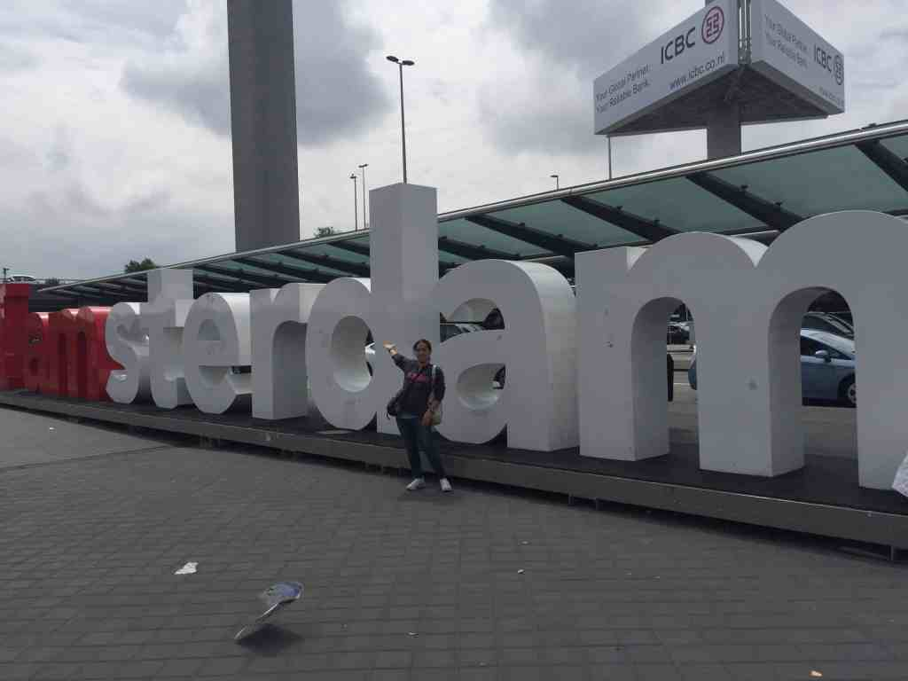 Amsterdam sign outside of airport