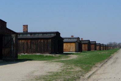 Row of reconstructed wooden barracks