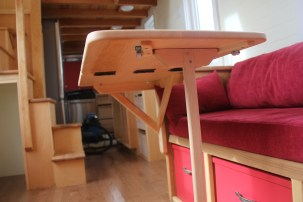 Pieces of wood on the underside help guide the stand into place
