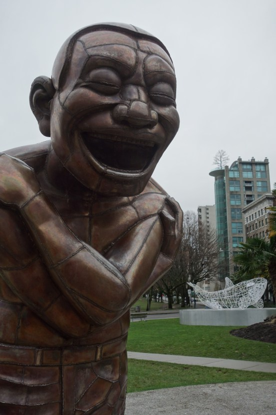 Laughing statues in Vancouver