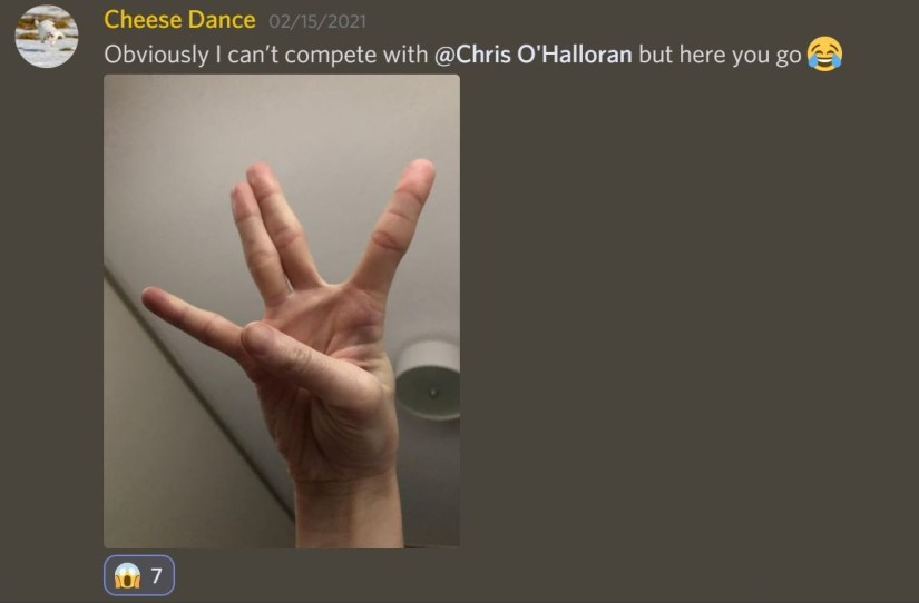 User @CheeseDance posts a photo of her hand doing the fairy hand signal (she has quite dexterous hands and this is the closest version anyone has posted to the fairy hand signal, save for photoshopped versions) and says 'Obviously I can't compete with @Chris O'Halloran but here you go' with a laughing emoji. Other users react with a scream emoji.