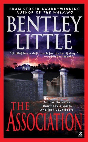 Cover of The Association by Bentley Little. Cover shows a stone fence with a wrought iron gate. The gate is open, and in the distance is a house, with windows visibly lit as the scene is set at dusk. Lightning strikes in the distance.