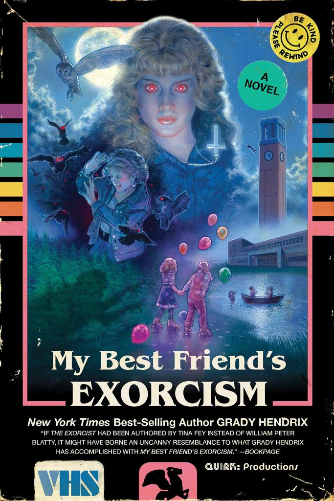 Cover of My Best Friend's Exorcism by Grady Hendrix. Cover is design to look like a VHS cassette sleeve and includes a bright pink border, rainbow colored stripes, a VHS logo, and a collage featuring a main illustration of two young girls holding hands and walking alongside a river, with a school in the background. In the sky, the collage also includes an illustration of another girl being attacked by red eyed owls, and an image of another girl with bright red eyes. The moon hangs in the sky.