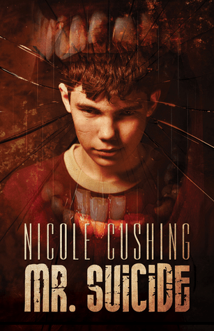 Cover of Mr Suicide by Nicole Cushing. Cover shows an image of a young boy staring directly at us with a very intense stare. Surrounding the boy's head is a superimposed image of a gaping wide mouth. We can only see the teeth.