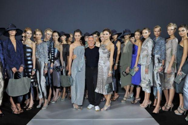 Giorgio Armani with female models