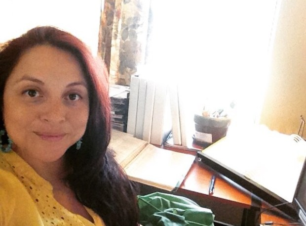 Woman sitting in a home office