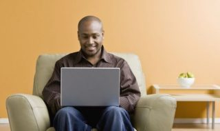 black man using a laptop