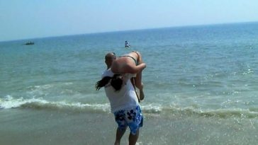 lady being thrown into the sea