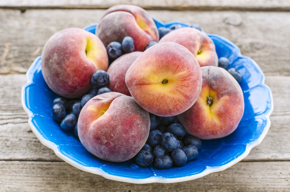 Blueberries and peaches-min