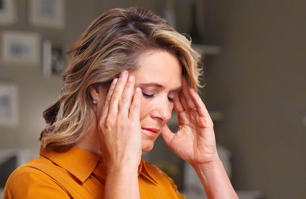 girl suffering fromMigraine
