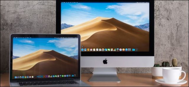 An iMac and a MacBook on a desk.