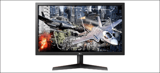 The LG UltraGear 24GL600F-B game monitor with on-screen video game planes.