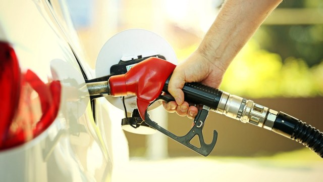 Man pumping gas, touching a pump handle loaded with germs.