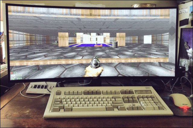 GZDoom on a large screen behind a keyboard and a desktop mouse.
