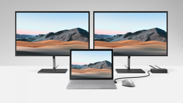A Surface Book 3 connected to two monitors via a Surface Dock 2