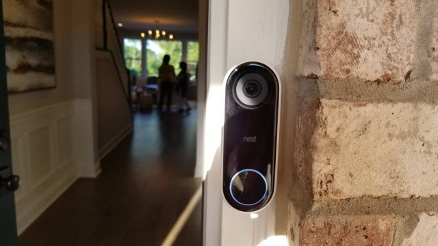 Nest Hello with a shiny blue button.