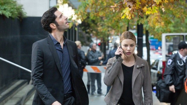 Lucifer and Chloé from the series 'Lucifer' walking on a street.