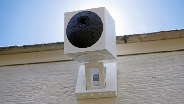 Wyze Cam Outdoor, wall mounted, covered with water drops