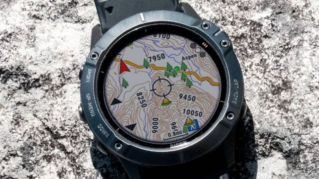 A Garmin Smartwatch with a map on the screen.