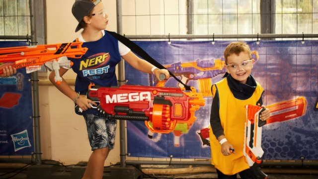 Boys with NERF guns at the playground