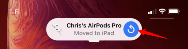 An iPhone notification saying AirPods moved to an iPad.
