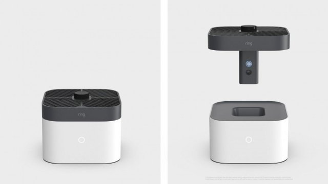 A Ring camera drone in and out of its dock.