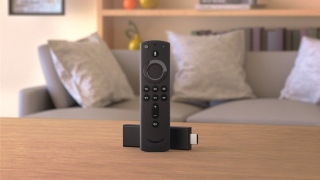 The Amazon Fire Stick in a living room. Display of the new voice remote control.